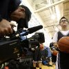 A photographer from ESPN films Van Hoosen\'s Owen Groesser during halftime of a middle school basketball game against Reuther, Thursday, Jan. 24, 2013, at Rochester High School in Rochester, Mich. Groesser, an eight-grader with Dwon Syndrome, made ESPN\'S SportsCenter Top 10 Plays after hitting two 3-pointers in the first game he got to play this season on Wednesday. (AP Photo/Detroit Free Press, Andre J. Jackson) DETROIT NEWS OUT; NO SALES; MAGS OUT; MANDATORY CREDIT