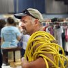 A man carries an electrical extension cord on his shoulder as he shops at a giant