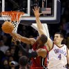Miami\'s Dwyane Wade puts up a shot despite pressure from Oklahoma City\'s Nick Collison during their NBA basketball game at the OKC Arena in Oklahoma City on Thursday, Jan. 30, 2011. The Heat beat the Thunder 108-103. Photo by John Clanton, The Oklahoman