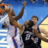 San Antonio\'s Kawhi Leonard (2) dunks in as Oklahoma City\'s Serge Ibaka (9) defends during Game 3 of the Western Conference Finals in the NBA playoffs between the Oklahoma City Thunder and the San Antonio Spurs at Chesapeake Energy Arena in Oklahoma City, Sunday, May 25, 2014. Photo by Nate Billings, The Oklahoman