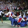 Czech Republic\'s team celebrates after Radek Stepanek, bottom, defeated Spain\'s Nicolas Almagro in their Davis Cup finals tennis singles match in Prague, Czech Republic, Sunday, Nov. 18, 2012. Czech Republic defeated Spain 3-2 and gained the Davis Cup trophy. (AP Photo/Petr David Josek)