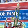 Sonya Thomas holds the first place trophy after winning the Nathan\'s Famous Fourth of July International Hot Dog Eating contest with a total of 36 and three quarters hot dogs and buns at Coney Island, Thursday, July 4, 2013, in the Brooklyn borough of New York. (AP Photo/John Minchillo)