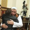 Egyptian members of parliament hug each other at the Parliament in Cairo, Egypt, Tuesday, July 10, 2012. Egypt\'s Islamist-dominated parliament opened a new front in the country\'s leadership showdowns Tuesday by meeting in defiance of orders that disbanded the chamber and brought President Mohammed Morsi in conflict with both the powerful military and the highest court. (AP Photo) ORG XMIT: CAI110