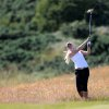 Photo - Sweden's Louise Larsson plays a shot from the rough on the 9th fairway during the second day of the Women's British Open golf championship on the Royal Birkdale Golf Club, Southport, England, Friday, July 11, 2014. (AP Photo/Scott Heppell)