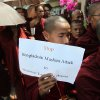 A Buddhist monk holds a banner as they stage a rally outside the Embassy of Bangladesh Friday, Oct. 5, 2012, in Yangon, Myanmar.More than 100 Buddhist monks demonstrated in front of the Bangladesh embassy in capital Yangon on Friday, condemning the recent attacks against Buddhist temples and houses in Bangladesh.(AP Photo/Khin Maung Win)