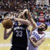 Photo - Philadelphia 76ers' Spencer Hawes, right, defends against Memphis Grizzlies' Marc Gasol, of Spain, during the first half of an NBA basketball game, Monday, Jan. 28, 2013, in Philadelphia. (AP Photo/Matt Slocum)