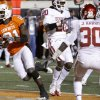 Oklahoma State\'s Justin Blackmon (81) scores a touchdown in front of Oklahoma\'s Quinton Carter (20) and Javon Harris (30) during the Bedlam college football game between the University of Oklahoma Sooners (OU) and the Oklahoma State University Cowboys (OSU) at Boone Pickens Stadium in Stillwater, Okla., Saturday, Nov. 27, 2010. Photo by Chris Landsberger, The Oklahoman