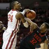 Oklahoma\'s Romero Osby (24) is fouled by Texas Tech\'s Jordan Tolbert (32) during an NCAA college basketball game between the University of Oklahoma and Texas Tech University at Lloyd Noble Center in Norman, Okla., Wednesday, Jan. 16, 2013. Photo by Bryan Terry, The Oklahoman
