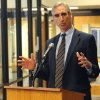 Photo - West Virginia University athletic director Oliver Luck speaks addresses the media during a news conference ,Thursday, Dec. 16, 2010, outside of his office at the WVU Coliseum in Morgantown, W.Va.  Luck spoke about the hiring of Oklahoma State offensive coordinator Dana Holgorsen as the school's head coach in waiting. Holgorsen will serve as the Mountaineers offensive coordinator for the 2011 season and then replace current head coach Bill Stewart in 2012. (AP Photo/The Dominion Post, Jason DeProspero)