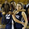 From left, Shawnee\'s Shaiann Tramble (22), Monique Tramble (33) and Bailey Taylor (20) react after losing the Class 5A girls championship high school basketball game in the state tournament at the Mabee Center in Tulsa, Okla., Saturday, March 9, 2013. Deer Creek defeated Shawnee, 59-44. Photo by Nate Billings, The Oklahoman