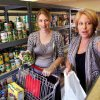 Photo - Lisa Wright, a counselor at Putnam City West High School, left,  and Heidi Albrecht, a Department of Human Services school- based social services worker, are shown in the food pantry at Putnam City West High School where students battling hunger can come to get food.   JIM BECKEL - THE OKLAHOMAN