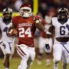 Oklahoma\'s Brennan Clay (24) runs on a fourth quarter touchdown in the college football game between the University of Oklahoma Sooners (OU) and the TCU Horned Frogs at Gaylord Family-Oklahoma Memorial Stadium in Norman, Okla., on Saturday, Oct. 5, 2013. Photo by Steve Sisney, The Oklahoman