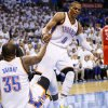 Oklahoma City\'s Russell Westbrook (0) helps Kevin Durant (35) up off the court after being knocked down during Game 2 in the first round of the NBA playoffs between the Oklahoma City Thunder and the Houston Rockets at Chesapeake Energy Arena in Oklahoma City, Wednesday, April 24, 2013. Oklahoma City won, 105-102. Photo by Nate Billings, The Oklahoman