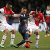 Photo - Paris Saint Germain's Marco Verratti of Italy, center, challenges for the ball with Monaco's Emmanuel Riviere of France, left, and Monaco's James Rodriguez of Colombia during their French League One soccer match, in Monaco stadium, Sunday, Feb. 9 , 2014. (AP Photo/Lionel Cironneau)