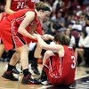 Photo - Davidson's Laura Murray (left) helps teammate Shannon Eriksson (right) up after a defensive play during the first half of the NCAA women's college basketball championship game of the Southern Conference tournament in Asheville, N.C., Monday, March 10, 2014. (AP Photo/Adam Jennings)