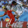 Photo - Switzerland's Xherdan Shaqiri, left, and Argentina's Ezequiel Garay go for a header during their World Cup round of 16 soccer match at the Itaquerao Stadium in Sao Paulo, Brazil, Tuesday, July 1, 2014. (AP Photo/Kirsty Wigglesworth)