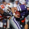 Oklahoma State\'s James Thomas (22) brings down Kansas State quarterback Carson Coffman (14) during the first half of the college football game between the Oklahoma State University Cowboys (OSU) and the Kansas State University Wildcats (KSU) on Saturday, Oct. 30, 2010, in Manhattan, Kan. Photo by Chris Landsberger, The Oklahoman