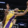 Photo - Los Angeles Lakers' Xavier Henry, center, passes the ball as he is defended by Los Angeles Clippers' Chris Paul during the first half of an NBA basketball game on Thursday, March 6, 2014, in Los Angeles. (AP Photo/Jae C. Hong)