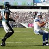 Photo -   Detroit Lions quarterback Matthew Stafford, right, scores on a one-yard run as Philadelphia Eagles cornerback Nnamdi Asomugha defends during the second half an NFL football game, Sunday, Oct. 14, 2012, in Philadelphia. (AP Photo/Mel Evans)