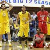 West Virginia\'s Gary Browne (14) reacts after a Radford turnover during the second half of an NCAA college basketball game at WVU Coliseum in Morgantown, W.Va., Saturday, Dec. 22, 2012. West Virginia defeated Radford 72-62. (AP Photo/David Smith)