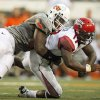 OSU\'s Nigel Nicholas takes down ULL quarterback Blaine Gautier for a sack during the Cowboys\' 61-34 win on Saturday in Stillwater. Photo by Nate Billings, The Oklahoman