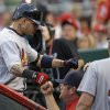 Photo - St. Louis Cardinals' Yadier Molina, left, is congratulated after hitting a solo home run off Cincinnati Reds starting pitcher Tony Cingrani in the fourth inning of a baseball game, Saturday, May 24, 2014, in Cincinnati. (AP Photo/Al Behrman)