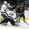 Los Angeles Kings goalie Jonathan Quick (32) stops a shot attempt by San Jose Sharks center Joe Thornton (19) during the first period of an NHL hockey game Saturday, April 7, 2012 in San Jose, Calif. (AP Photo/Marcio Jose Sanchez)