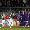 Photo - Juventus' Andrea Pirlo, left, scores during an Europa League, round of 16, return-leg soccer match between Fiorentina and Juventus, at the Artemio Franchi stadium in Florence, Italy, Thursday, March 20,, 2014. (AP Photo/Fabrizio Giovannozzi)
