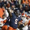 Photo - Virginia quarterback David Watford (5) tosses a pass during the first half of an NCAA college football game against Clemson in Charlottesville, Va., Saturday, Nov. 2, 2013.   (AP Photo/Steve Helber)