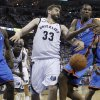 Memphis Grizzlies center Marc Gasol (33), of Spain, knocks the ball away from Oklahoma City Thunder forward Kevin Durant during the third overtime of Game 4 of a second-round NBA basketball playoff series on Tuesday, May 10, 2011, in Memphis, Tenn. Oklahoma City won 133-123 in triple overtime. Also shown are Oklahoma City Thunder forward Serge Ibaka (9) and Russell Westbrook (0). (AP Photo/Lance Murphey)
