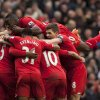 Photo - Liverpool's Daniel Sturridge, unseen,  is swamped by jubilant teammates as he celebrates scoring his team's fourth goal against Arsenal during their English Premier League soccer match at Anfield Stadium, Liverpool, England, Saturday Feb. 8, 2014. (AP Photo/Jon Super)