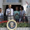 President Barack Obama, accompanied by first lady Michelle Obama, daughters Sasha and Malia, The Easter Bunny and Robby Novak, better known as Kid President, speaks to the crowd on the South Lawn from the Truman Balcony of the White House in Washington, Monday, April 1, 2013, during the annual Easter Egg Roll. (AP Photo/Susan Walsh)