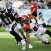 San Diego Chargers defensive back Corey Lynch (41) runs upfield after grabbing an interception as Cincinnati Bengals wide receiver Marvin Jones, right, watches during the second half of an NFL football game, Sunday, Dec. 2, 2012, in San Diego. (AP Photo/Denis Poroy)