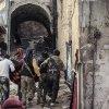 Photo -   In this Tuesday, Oct. 30, 2012 photo, a group of Free Syrian Army fighters carry a wounded comrade to cover in the town of Harem, Syria. The phrases to describe some of the looming foreign policy challenges for U.S. President Barack Obama didn't even exist when he took the oath of office the first time: the Arab Spring, the Fordo Facility housing Iran's underground uranium enrichment labs, the stealth power of new viruses bearing names such as Stuxnet and Flame in the shadow world of cyber-sabotage.U.S. allies appear to be anticipating a new, bolder approach from Obama on Syria in his second term _ but it remains to be seen if the U.S. plans to change course in any significant way in a conflict that has already claimed more than 36,000 lives since March 2011.(AP Photo/Mustafa Karali)