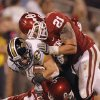 Oklahoma\'s Aaron Colvin and Tom Wort stops Missouri\'s T.J. Moe during their game Saturday in Norman. OU won 38-28.Photo by Chris Landsberger, The Oklahoman