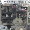 Photo - This image taken from video obtained from the Shaam News Network, which has been authenticated based on its contents and other AP reporting, shows a damaged building due to heavy shelling in the Damascus suburb of Daraya, Syria, on Wednesday, April 3, 2013. (AP Photo/Shaam News Network via AP video)