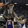 Los Angeles Lakers center Dwight Howard, left, grabs a rebound against Sacramento Kings forward Chuck Hayes during the fourth quarter of an NBA basketball game in Sacramento, Calif., Saturday, March 30, 2013. The Lakers won 103-98.(AP Photo/Rich Pedroncelli)