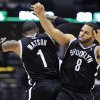 Photo - Brooklyn Nets' C.J. Watson (1) celebrates with Deron Williams (8) after Williams' late basket against the Milwaukee Bucks during the second half of an NBA basketball game, Wednesday, Feb. 20, 2013, in Milwaukee. The Nets won 97-94. (AP Photo/Jim Prisching)