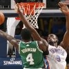 Oklahoma City\'s Serge Ibaka defends against Nate Robinson during the NBA basketball game between the Oklahoma City Thunder and the Boston Celtics, Sunday, Nov. 7, 2010, at the Oklahoma City Arena. Photo by Sarah Phipps, The Oklahoman