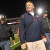 Mississippi head coach Houston Nutt, foreground, smiles as he is escorted off the field after their NCAA college football game against Northern Arizona in Oxford, Miss., Saturday, Nov. 7, 2009. (AP Photo/The Clarion-Ledger,Ryan Moore) ORG XMIT: MSJAD103