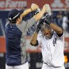 Photo -   New York Yankees' Nick Swisher, left, douses teammate Eduardo Nunez with water after they defeated the Oakland Athletics 10-9 during the 14th inning of a baseball game on Saturday, Sept. 22, 2012, at Yankee Stadium in New York. (AP Photo/Bill Kostroun)