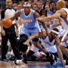 Denver\'s Al Harrington (7) gains control of the ball beside Oklahoma City\'s Lazar Hayward (11) during the NBA basketball game between the Oklahoma City Thunder and the Denver Nuggets at Chesapeake Energy Arena in Oklahoma City, Wednesday, April 25, 2012. Photo by Bryan Terry, The Oklahoman