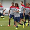 Photo - United States' Brad Davis, left, keeps the ball in the air as teammates look on during a training session at the Sao Paulo FC training center in Sao Paulo, Brazil, Monday, June 9, 2014. The U.S. will play in group G of the 2014 soccer World Cup. (AP Photo/Julio Cortez)
