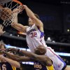 Los Angeles Clippers power forward Blake Griffin, right, dunks over Los Angeles Lakers power forward Lamar Odom, lower right, and power forward Pau Gasol of Spain during the first half of their NBA basketball game, Wednesday, Dec. 8, 2010, in Los Angeles. The play was called by because of a loose ball foul. (AP Photo/Mark J. Terrill)
