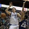 Dallas Mavericks power forward Dirk Nowitzki (41) loses control of the ball after being fouled by New Orleans Pelicans\' Anthony Davis (23) on a shot attempt in the first half of an NBA basketball game, Saturday, Jan. 11, 2014, in Dallas. (AP Photo/Tony Gutierrez)
