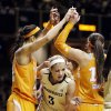 Vanderbilt forward Heather Bowe (3) squeezes out of a huddle by Tennessee players including Isabelle Harrison, left, and Taber Spani, right, after Tennessee scored in the first half of an NCAA basketball game, Thursday, Jan. 24, 2013, in Nashville, Tenn. (AP Photo/Mark Humphrey)