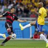 Photo - Germany's Mats Hummels, left, and Brazil's Maicon challenge for a ball during the World Cup semifinal soccer match between Brazil and Germany at the Mineirao Stadium in Belo Horizonte, Brazil, Tuesday, July 8, 2014. (AP Photo/Frank Augstein)