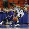 Sydney Colson (51) and Shalee Lehning try for a loose ball during the 2009 Big 12 Women\'s Basketball Championship game between Kansas State Wildcats and the Texas A&M Aggies in the Cox Convention Center in Oklahoma City, Oklahoma, on Friday, March 13, 2009. PHOTO BY STEVE SISNEY, THE OKLAHOMAN
