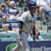 Photo - San Diego Padres' Yangervis Solarte throws his bat to the ground after a swinging strike three against the Atlanta Braves during the third inning of a baseball game Monday, July 28, 2014, in Atlanta. (AP Photo/David Tulis)