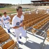 Photo - Los Angeles Dodgers pitcher Clayton Kershaw leads teammates running stairs during spring training baseball practice in Glendale, Ariz., Friday, Feb. 14, 2014. (AP Photo/Paul Sancya)